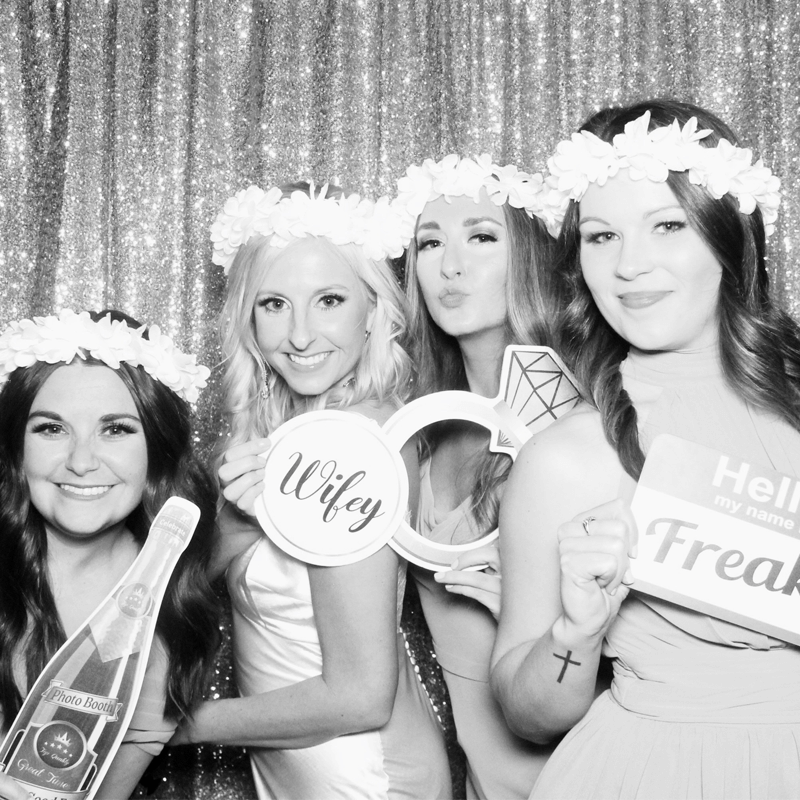 bride with bridesmaids in photo booth black & white photo